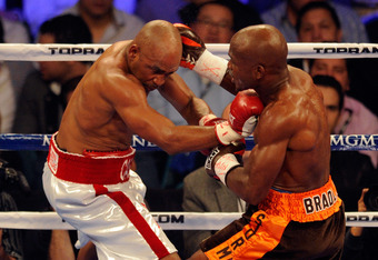 LAS VEGAS, NV - NOVEMBER 12:  (R-L) Timothy Bradley throws a right to the head of Joel Casamayor during their WBO junior welterweight title fight at the MGM Grand Garden Arena on November 12, 2011 in Las Vegas, Nevada.  (Photo by Ethan Miller/Getty Images