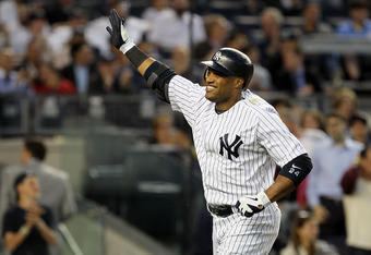 NEW YORK, NY - JUNE 06:  Robinson Cano #24 of the New York Yankees celebrates his fourth inning home run against the Tampa Bay Rays at Yankee Stadium on June 6, 2012  in the Bronx borough of New York City.  (Photo by Jim McIsaac/Getty Images)