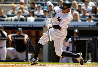 NEW YORK, NY - APRIL 29: Curtis Granderson #14 of the New York Yankees hits a solo home run in the fourth inning against the Detroit Tigers at Yankee Stadium on April 29, 2012 in the Bronx borough of New York City.  (Photo by Mike Stobe/Getty Images)