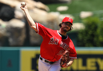 ANAHEIM, CA - JUNE 03:  Dan Haren #24 of the Los Angeles Angels of Anaheim throws a pitch against the Texas Rangers at Angel Stadium of Anaheim on June 3, 2012 in Anaheim, California.  (Photo by Stephen Dunn/Getty Images)