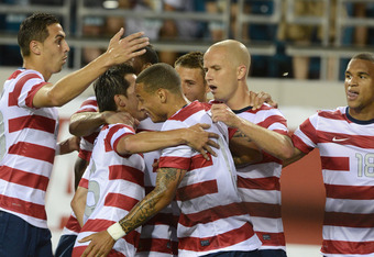 JACKSONVILLE, FL - MAY 26: Michael Bradley #4 is surrounded by members of Team USA after scoring the second goal against Team Scotland on May 26, 2012 at EverBank Field in Jacksonville, FL.  (Photo by Gary Bogdon/Getty Images)