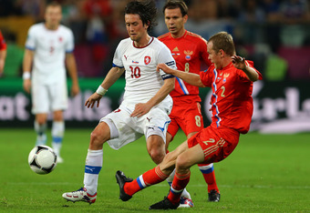 WROCLAW, POLAND - JUNE 08:   Tomas Rosicky of Czech Republic and Aleksandr Anyukov of Russia compete for the ball during the UEFA EURO 2012 group A match between Russia and Czech Republic at The Municipal Stadium on June 8, 2012 in Wroclaw, Poland.  (Phot