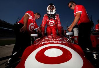 FORT WORTH, TX - JUNE 08:  Scott Dixon of New Zealand, driver of the #9 Target Chip Ganassi Racing Honda Dallara, climbs into his car to qualify for the IZOD IndyCar Series Firestone 550 at Texas Motor Speedway on June 8, 2012 in Fort Worth, Texas.  (Phot