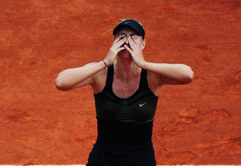 PARIS, FRANCE - JUNE 09:  Maria Sharapova of Russia celebrates match point in the women's singles final against Sara Errani of Italy during day 14 of the French Open at Roland Garros on June 9, 2012 in Paris, France.  (Photo by Mike Hewitt/Getty Images)