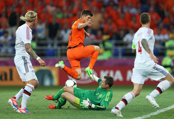 KHARKOV, UKRAINE - JUNE 09:  Klaas Jan Huntelaar of Netherlands tries to chip the ball over goalkeeper Stephan Andersen of Denmark during the UEFA EURO 2012 group B match between Netherlands and Denmark at Metalist Stadium on June 9, 2012 in Kharkov, Ukra
