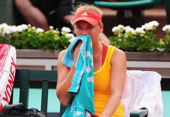 PARIS, FRANCE - JUNE 02:  Caroline Wozniacki of Denmark looks dejected in her women's singles third round match against Kaia Kanepi of Estonia during day 7 of the French Open at Roland Garros on June 2, 2012 in Paris, France.  (Photo by Mike Hewitt/Getty