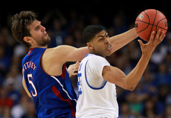 NEW ORLEANS, LA - APRIL 02:  Anthony Davis #23 of the Kentucky Wildcats grabs the ball next to Jeff Withey #5 of the Kansas Jayhawks in the first half in the National Championship Game of the 2012 NCAA Division I Men's Basketball Tournament at the Mercede