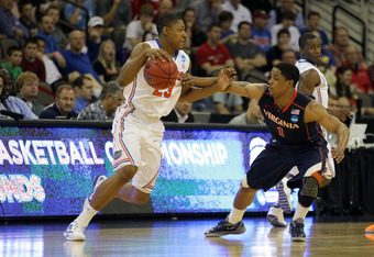 OMAHA, NE - MARCH 16:  Bradley Beal #23 of the Florida Gators drives in the first half against Jontel Evans #1 of the Virginia Cavaliers during the second round of the 2012 NCAA Men's Basketball Tournament at CenturyLink Center on March 16, 2012 in Omaha,