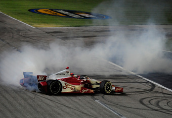 FORT WORTH, TX - JUNE 09:  Justin Wilson of England, driver of the #18 Sonny's BBQ Honda Dallara, performs a burnout to celebrate winning the IZOD IndyCar Series Firestone 550 at Texas Motor Speedway on June 9, 2012 in Fort Worth, Texas.  (Photo by Robert