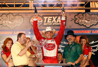 Justin Wilson celebrates his first career victory on an oval in victory lane.