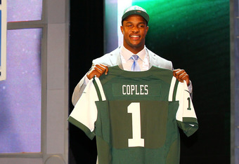 NEW YORK, NY - APRIL 26:  Quinton Coples of North Carolina holds up a jersey as he stands on stage after he was selected #16 overall by the New York Jets in the first round of the 2012 NFL Draft at Radio City Music Hall on April 26, 2012 in New York City.