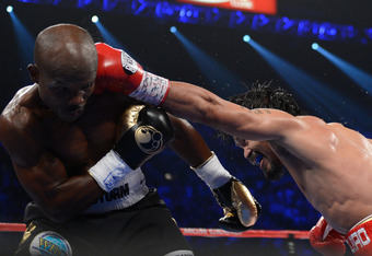 LAS VEGAS, NV - JUNE 09:  (R-L) Manny Pacquiao lands a left to the head of Timothy Bradley during their WBO welterweight title fight at MGM Grand Garden Arena on June 9, 2012 in Las Vegas, Nevada.  (Photo by Kevork Djansezian/Getty Images)