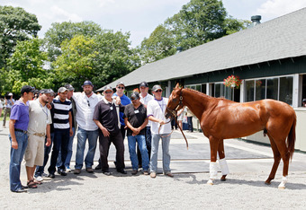 ELMONT, NY - JUNE 08:  Trainer Doug O'Neil and I'll Have Another stand with their team after a press conference outside of barn two on June 8, 2012 in Elmont, New York.    It was announced earlier in the day that I'll Have Another has been scratched from