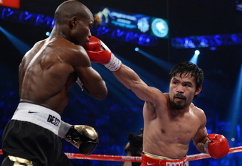 LAS VEGAS, NV - JUNE 09:  (R-L) Manny Pacquiao lands a right to the head of Timothy Bradley during their WBO welterweight title fight at MGM Grand Garden Arena on June 9, 2012 in Las Vegas, Nevada.  (Photo by Kevork Djansezian/Getty Images)