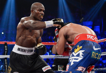 LAS VEGAS, NV - JUNE 09:  (L-R) Timothy Bradley lands a right to the head of Manny Pacquiao during their WBO welterweight title fight at MGM Grand Garden Arena on June 9, 2012 in Las Vegas, Nevada.  (Photo by Kevork Djansezian/Getty Images)