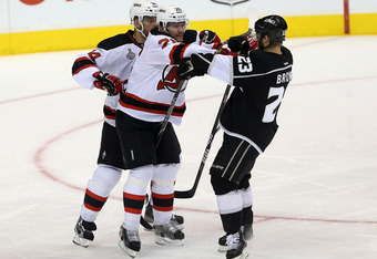 LOS ANGELES, CA - JUNE 06:  David Clarkson #23 of the New Jersey Devils and Dustin Brown #23 of the Los Angeles Kings tangle in Game Four of the 2012 Stanley Cup Final at Staples Center on June 6, 2012 in Los Angeles, California.  (Photo by Bruce Bennett/