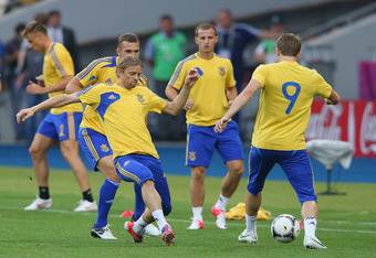 KIEV, UKRAINE - JUNE 10:  Anatoliy Tymoschchuk of Ukraine tackles Oleh Gusev during a UEFA EURO 2012 training session at the Olympic Stadium on June 10, 2012 in Kiev, Ukraine.  (Photo by Alex Livesey/Getty Images)