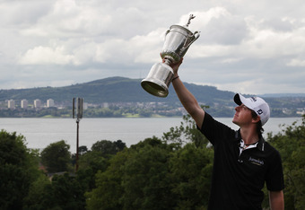 BELFAST, NORTHERN IRELAND - JUNE 22:  US Open winning golfer Rory McIlroy poses with his trophy on a green at Holywood Golf Club on June 22, 2011 in Belfast, Northern Ireland. The 22 year old golfer has returned home to his native Northern Ireland and is