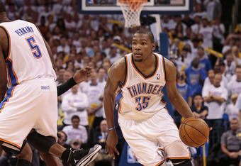 OKLAHOMA CITY, OK - JUNE 06:  Kevin Durant #35 drives after a Kendrick Perkins #5 of the Oklahoma City Thunder pick against the San Antonio Spurs in Game Six of the Western Conference Finals in the 2012 NBA Playoffs on June 6, 2012 at the Chesapeake Energ