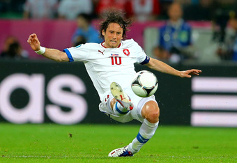 WROCLAW, POLAND - JUNE 08:  Tomas Rosicky of Czech Republic in action during the UEFA EURO 2012 group A match between Russia and Czech Republic at The Municipal Stadium on June 8, 2012 in Wroclaw, Poland.  (Photo by Christof Koepsel/Getty Images)