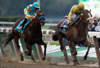 ELMONT, NY - JUNE 09:  Union Rags ridden by John Velazquez (R) outruns Paynter ridden by Mike Smith (L) to win the 144th Belmont Stakes at Belmont Park on June 9, 2012 in Elmont, New York.  (Photo by Rob Carr/Getty Images)