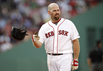 BOSTON, MA - JUNE 9:  Kevin Youkilis #20 of the Boston Red Sox tosses his helmet after flying out during the eighth inning of their 4-2 loss to the Washington Nationals in interleague play at Fenway Park on June 9, 2012 in Boston, Massachusetts.  (Photo b