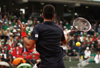 PARIS, FRANCE - JUNE 10:  Novak Djokovic of Serbia plays a forehand during the men's singles final against Rafael Nadal of Spain on day 15 of the French Open at Roland Garros on June 10, 2012 in Paris, France.  (Photo by Matthew Stockman/Getty Images)