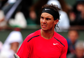 PARIS, FRANCE - JUNE 10:  Rafael Nadal of Spain celebrates a point during the men's singles final against Novak Djokovic of Serbia on day 15 of the French Open at Roland Garros on June 10, 2012 in Paris, France.  (Photo by Mike Hewitt/Getty Images)