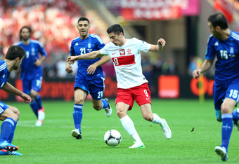 WARSAW, POLAND - JUNE 08:  Robert Lewandowski of Poland on the ball during the UEFA EURO 2012 group A match between Poland and Greece at The National Stadium on June 8, 2012 in Warsaw, Poland.  (Photo by Michael Steele/Getty Images)