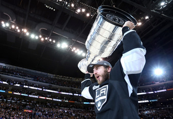 LOS ANGELES, CA - JUNE 11:  Mike Richards #10 of the Los Angeles Kings holds up the Stanley Cup after the Kings defeated the New Jersey Devils 6-1 to win the Stanley Cup series 4-2 in Game Six of the 2012 Stanley Cup Final at Staples Center on June 11, 20
