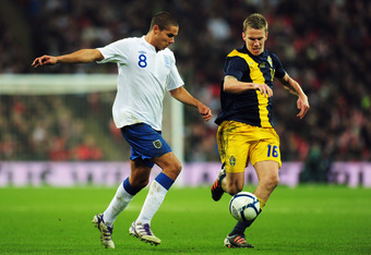 LONDON, ENGLAND - NOVEMBER 15:  Jack Rodwell of England takes on Pontus Wernbloom of Sweden during the international friendly match between England and Sweden at Wembley Stadium on November 15, 2011 in London, England.  (Photo by Shaun Botterill/Getty Ima
