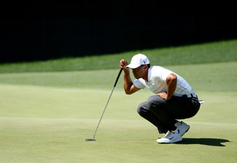 AUGUSTA, GA - APRIL 07:  Tiger Woods of the United States lines up a putt during the third round of the 2012 Masters Tournament at Augusta National Golf Club on April 7, 2012 in Augusta, Georgia.  (Photo by Jamie Squire/Getty Images)
