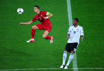 L'VIV, UKRAINE - JUNE 09:  Cristiano Ronaldo of Portugal and Jerome Boateng of Germany during the UEFA EURO 2012 group B match between Germany and Portugal at Arena Lviv on June 9, 2012 in L'viv, Ukraine.  (Photo by Laurence Griffiths/Getty Images)