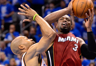 OKLAHOMA CITY, OK - JUNE 12:  Dwyane Wade #3 of the Miami Heat goes up for a shot over Derek Fisher #37 of the Oklahoma City Thunder in the second half in Game One of the 2012 NBA Finals at Chesapeake Energy Arena on June 12, 2012 in Oklahoma City, Oklaho
