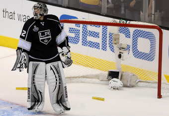 LOS ANGELES, CA - JUNE 11:  Goaltender Jonathan Quick #32 of the Los Angeles Kings looks on after the net is dislodged against the New Jersey Devils in Game Six of the 2012 Stanley Cup Final at Staples Center on June 11, 2012 in Los Angeles, California.