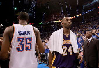 OKLAHOMA CITY, OK - MAY 21:  Kobe Bryant #24 of the Los Angeles Lakers walks past Kevin Durant #35 of the Oklahoma City Thunder after a 106-90 loss during Game Five of the Western Conference Semifinals of the 2012 NBA Playoffs at Chesapeake Energy Arena o