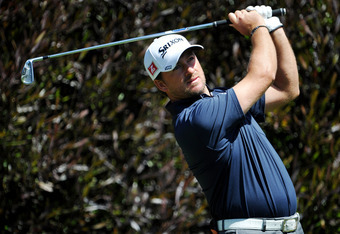 SAN FRANCISCO, CA - JUNE 12: Graeme McDowell of Northern Ireland hits a shot during a practice round prior to the start of the 112th U.S. Open at The Olympic Club on June 12, 2012 in San Francisco, California.  (Photo by Stuart Franklin/Getty Images)