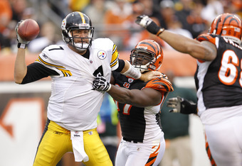 CINCINNATI, OH - NOVEMBER 13: Geno Atkins #97 of the Cincinnati Bengals sacks Ben Roethlisberger #7 of the Pittsburgh Steelers during the first half of their game at Paul Brown Stadium on November 13, 2011 in Cincinnati, Ohio. (Photo by Joe Robbins/Getty