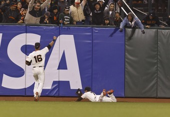 SAN FRANCISCO, CA - JUNE 13: Gregor Blanco #7 of the San Francisco Giants makes a diving catch in front of a fly ball hit off the bat of Jordan Schafer #1 of the Houston Astros (not pictured) during the seventh inning in front of Angel Pagan #16 at AT&T P