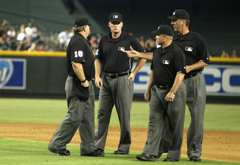 Umpire Ted Barrett (second from left) is the first umpire in MLB history to have worked home plate for two perfect games. Umpire Brian Runge (No. 18, left) recently became the 10th official to have called balls and strikes for two no-hitters during the same season. Also pictured are umpires Tim McClelland (right) and Marvin Hudson.