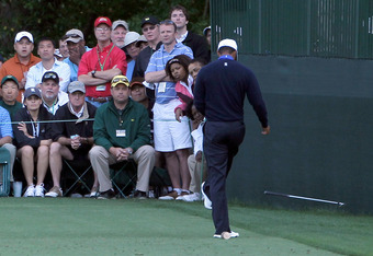 Tiger's uncouth behavior at the Masters included kicking his club after poor shots.