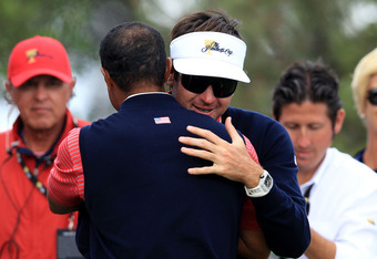 MELBOURNE, AUSTRALIA - NOVEMBER 20:  Bubba Watson of the U.S. Team and team mate Tiger Woods celebrate winning the Day Four Singles Matches of the 2011 Presidents Cup at Royal Melbourne Golf Course on November 20, 2011 in Melbourne, Australia.  (Photo by