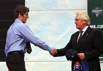 ST PAUL, MN - JUNE 24:  Fifteenth overall pick Jonathan Miller by the New York Rangers shakes hands with General Manager Glen Sather of the New York Rangers during day one of the 2011 NHL Entry Draft at Xcel Energy Center on June 24, 2011 in St Paul, Minn
