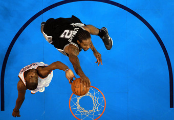 OKLAHOMA CITY, OK - JUNE 06:  Kevin Durant #35 of the Oklahoma City Thunder blocks the dunk of Kawhi Leonard #2 of the San Antonio Spurs in Game Six of the Western Conference Finals of the 2012 NBA Playoffs at Chesapeake Energy Arena on June 6, 2012 in Ok