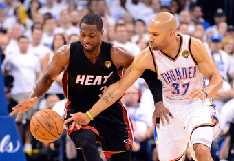 OKLAHOMA CITY, OK - JUNE 14:  Dwyane Wade #3 of the Miami Heat and Derek Fisher #37 of the Oklahoma City Thunder go after the ball late in the fourth quarter in Game Two of the 2012 NBA Finals at Chesapeake Energy Arena on June 14, 2012 in Oklahoma City,