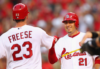 ST. LOUIS, MO - JUNE 14: Allen Craig #21 of the St. Louis Cardinals congratulates David Freese #23 also of the St. Louis Cardinals after Freese hit a two-run home run against the Chicago White Sox at Busch Stadium on June 14, 2012 in St. Louis, Missouri.