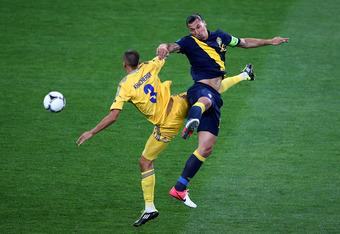 KIEV, UKRAINE - JUNE 11: Zlatan Ibrahimovic of Sweden and Yevhen Khacheridi of Ukraine clash during the UEFA EURO 2012 group D match between Ukraine and Sweden at The Olympic Stadium on June 11, 2012 in Kiev, Ukraine.  (Photo by Martin Rose/Getty Images)