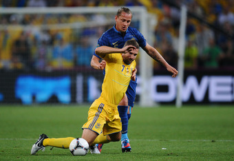 DONETSK, UKRAINE - JUNE 15:  Philippe Mexes of France and  Andriy Shevchenko of Ukraine clash during the UEFA EURO 2012 group D match between Ukraine and France at Donbass Arena on June 15, 2012 in Donetsk, Ukraine.  (Photo by Lars Baron/Getty Images)