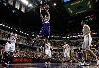 INDIANAPOLIS, IN - MARCH 11:  John Shurna #24 of the Northwestern Wildcats dunks against the Ohio State Buckeyes during the quarterfinals of the 2011 Big Ten Men's Basketball Tournament at Conseco Fieldhouse on March 11, 2011 in Indianapolis, Indiana. Ohi