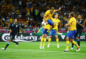 KIEV, UKRAINE - JUNE 15:  Olof Mellberg of Sweden scores their second goal during the UEFA EURO 2012 group D match between Sweden and England at The Olympic Stadium on June 15, 2012 in Kiev, Ukraine.  (Photo by Laurence Griffiths/Getty Images)